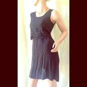 Black sleeveless dress with eyelet detail